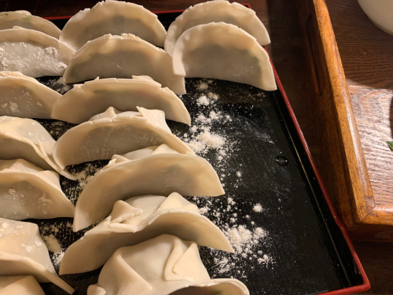 A series of dumplings being made